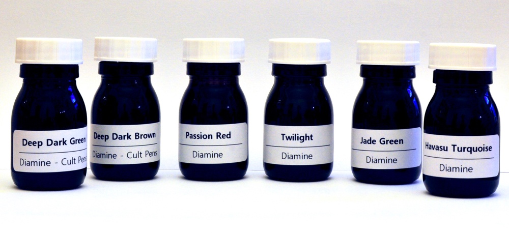 A range of Diamine Inks in Sirop bottles